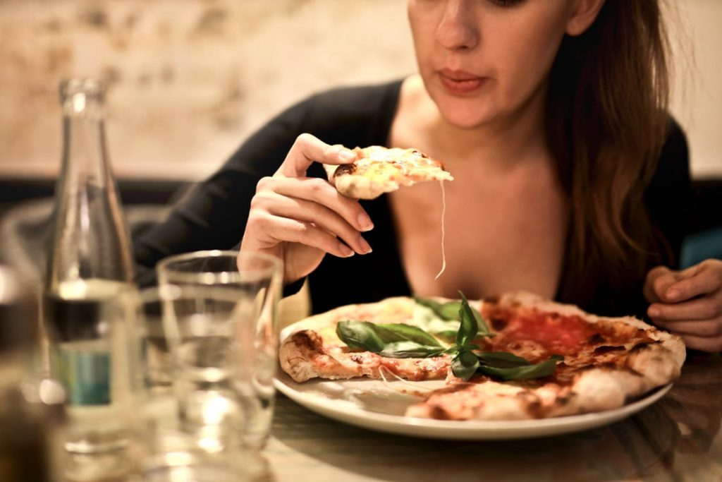 Woman eating Italian Food in Westlake Village