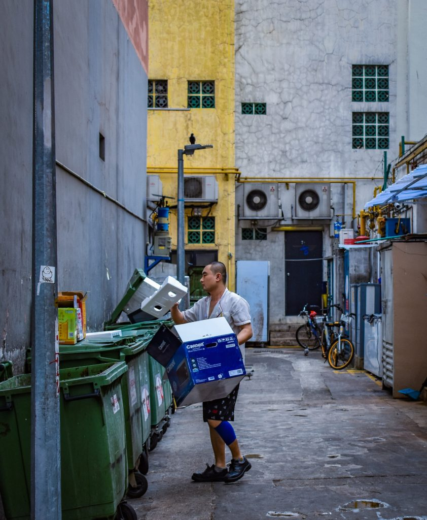 man recycling trash