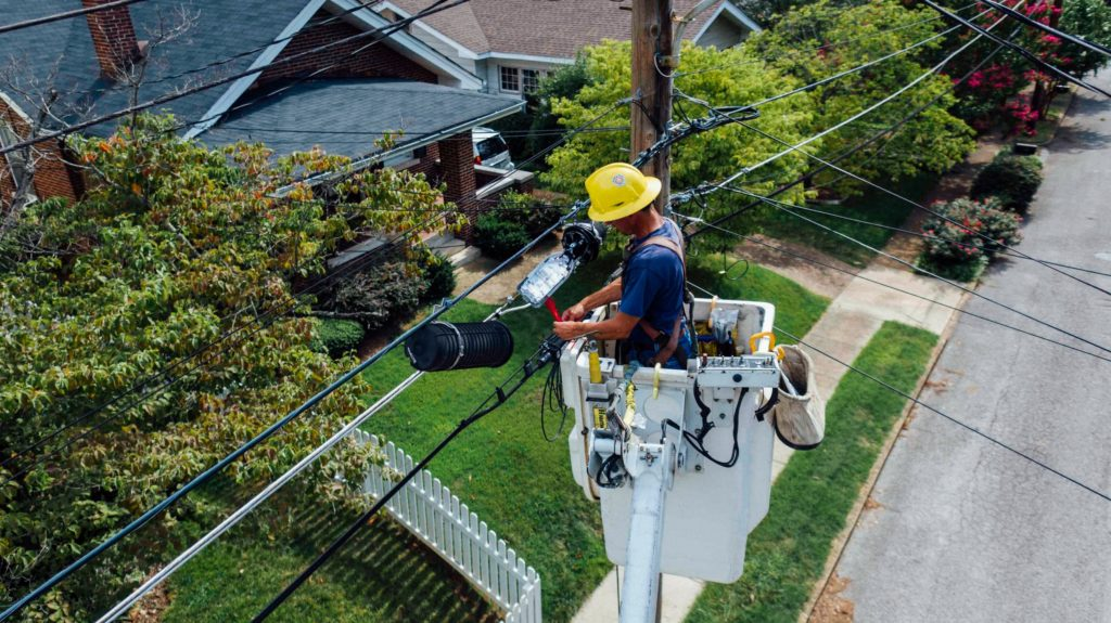 man fixing electrical pole