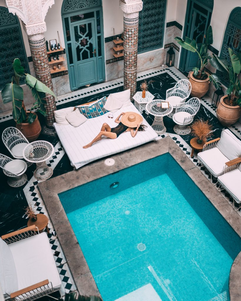 woman by pool in luxury vacationhome