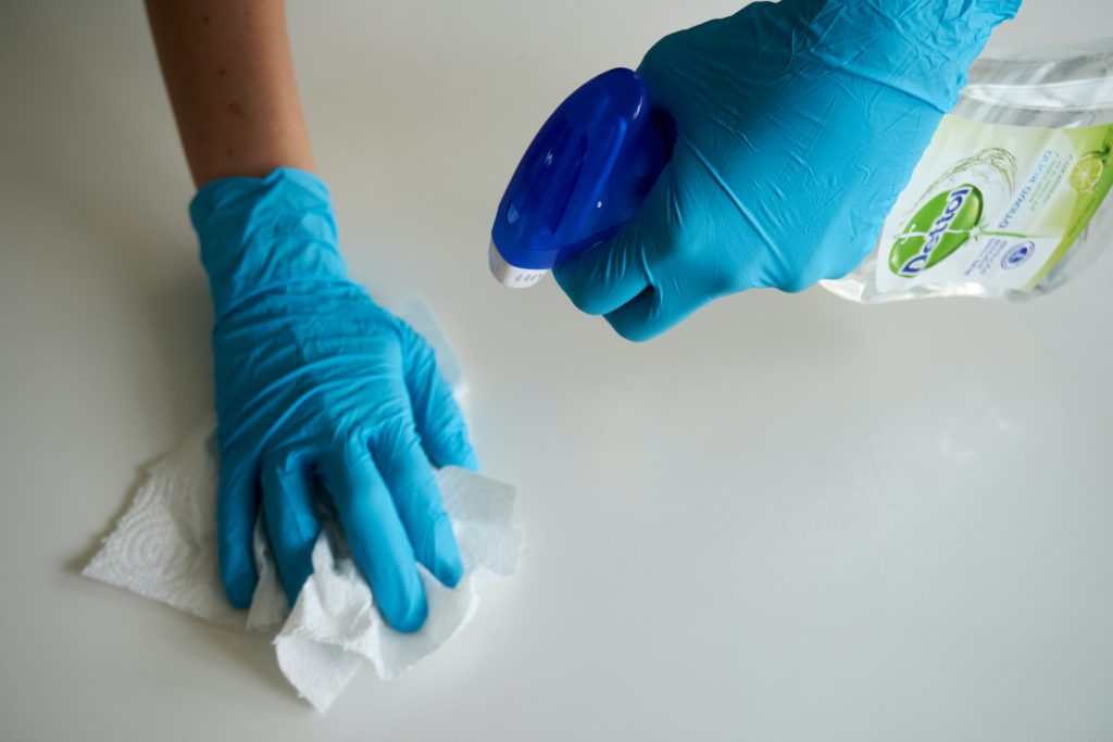 cleaning spray with gloves